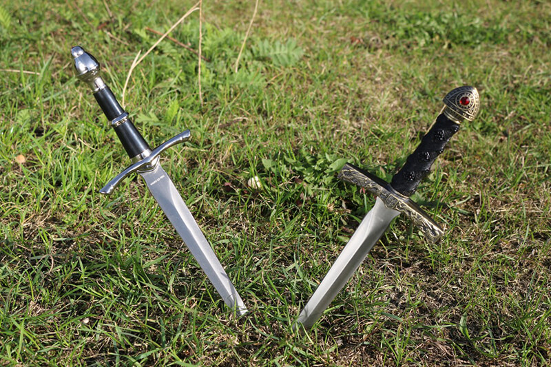 two daggers in the grass